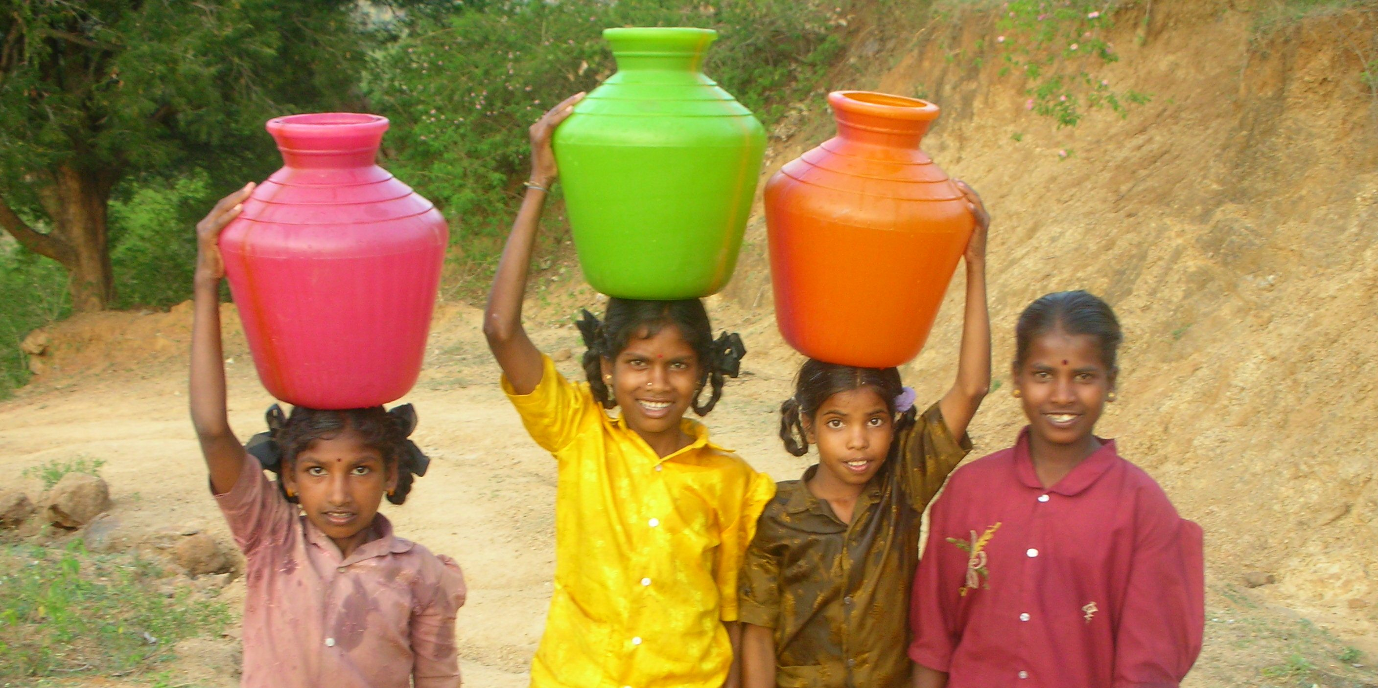 Children travel in train to get water for home